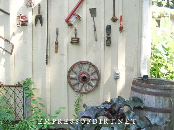 Old tools hanging on shed walls.
