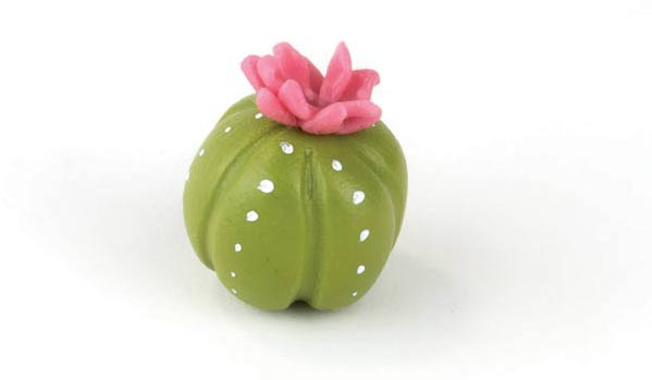 Pink petals on top of green ball.