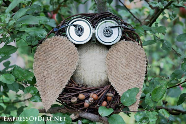 Garden art owl made from grapevine wreath and burlap.