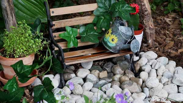 Make a fairy garden come to life with a quirky spilling watering can fountain that really works.