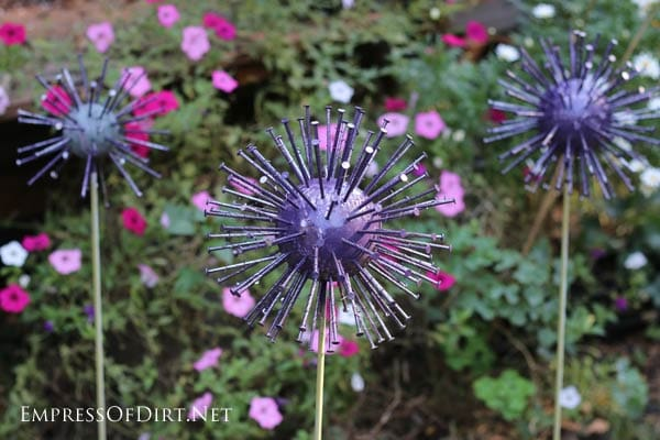 Have you ever seen giant, purple alliums in bloom in the spring? This is a quick and easy garden art project made from thrift shop items to mimic the look of those massive, globe-shaped flowers.