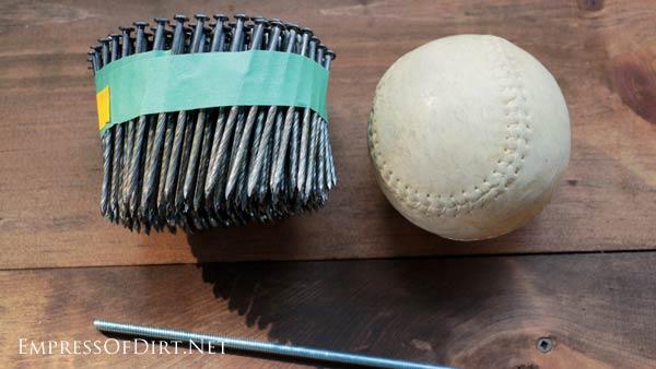 Supplies for making garden art alliums: nails, softball, and metal rod.