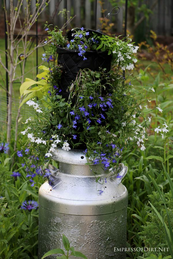 The best flower containers come from unusual, repurposed items like this old bird feeder.