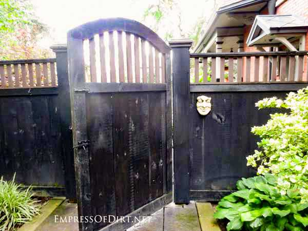 Black garden fence and gate.