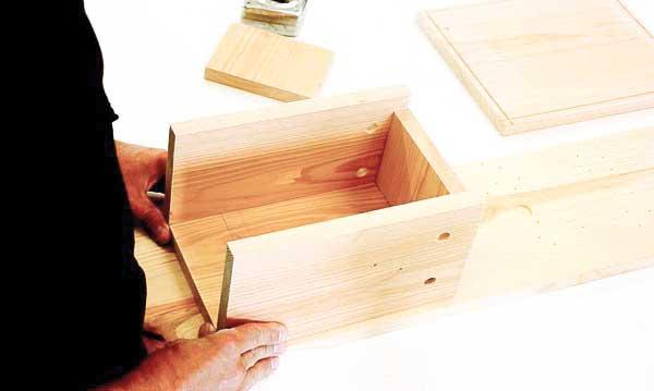 Assembling nesting box.