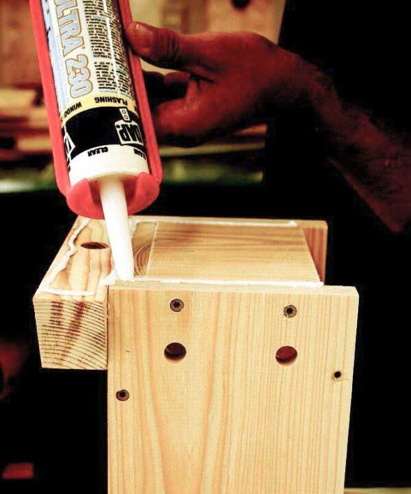 Applying glue to nesting box.