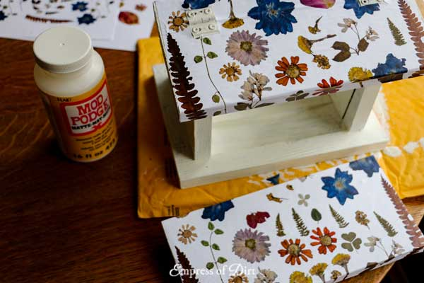 Turn a plain birdfeeder into a botanical beauty with this pressed flower art project. And, good news, you can adapt the project to fit what you have—fresh, pressed flowers not required.