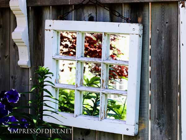 Mirrors can brighten dark garden areas.
