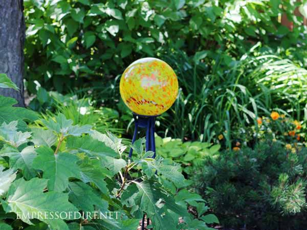 Add a bright garden ball to a dark shade garden bed.