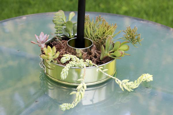 A bundt cake pan makes a perfect umbrealla table planter.