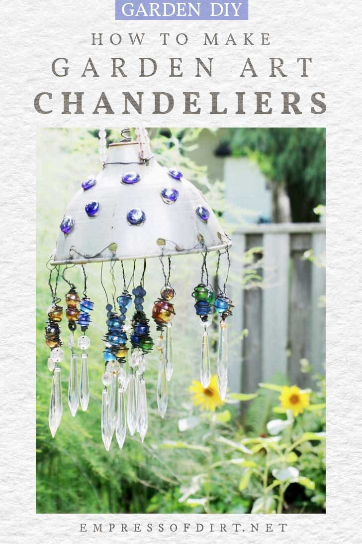 Upcycled garden art chandelier with marbles and crystals.
