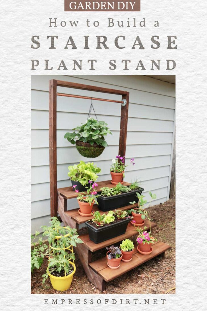 staircase plant stand with flowers in containers.