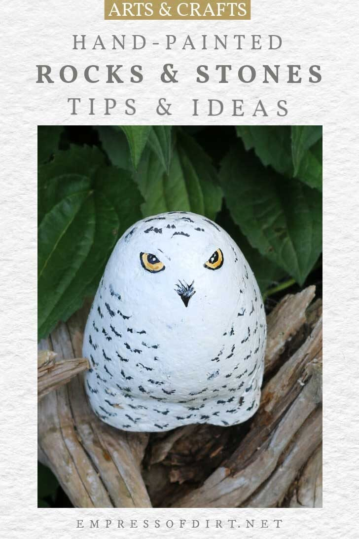 Rock painted to look like a snowy owl.