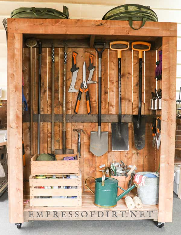 Portable tool shed with nicely organized garden tools.