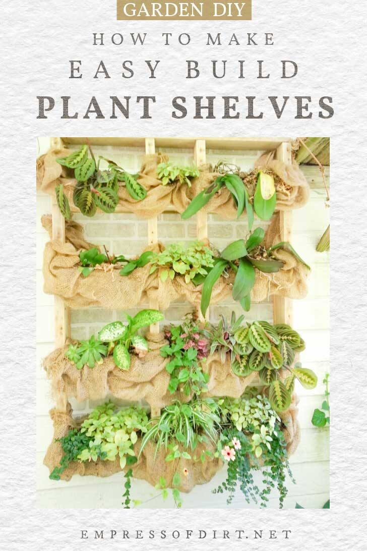 Outdoor plant shelf hanging on wall with burlap fabric and plants.