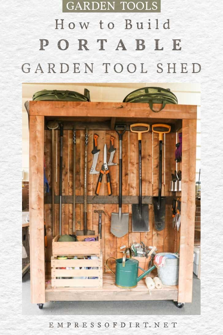 Portable wooden garden tool shed on wheels.