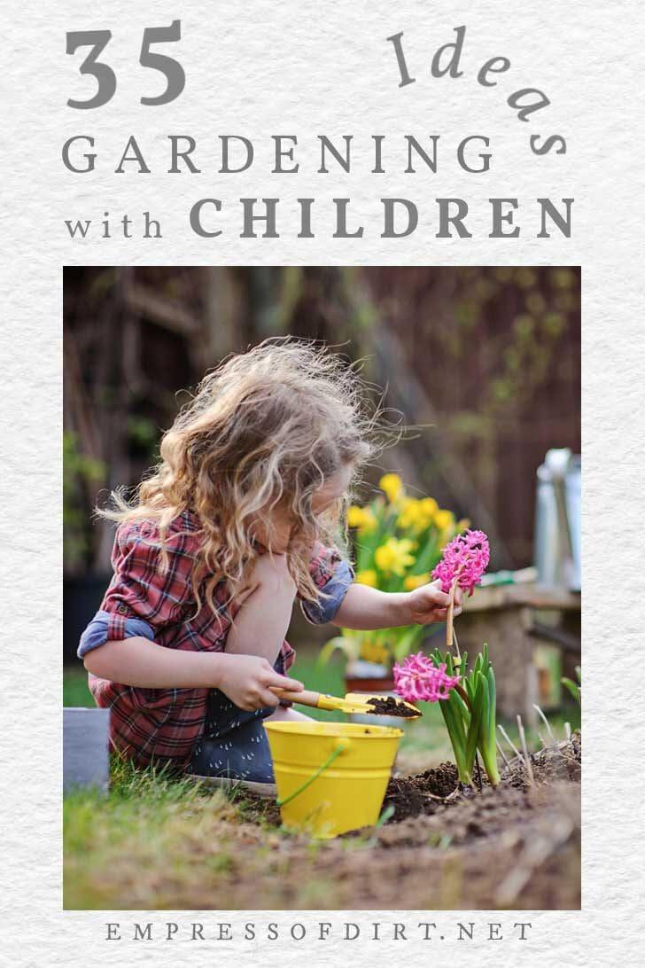 Little girl planting flowers in the garden.