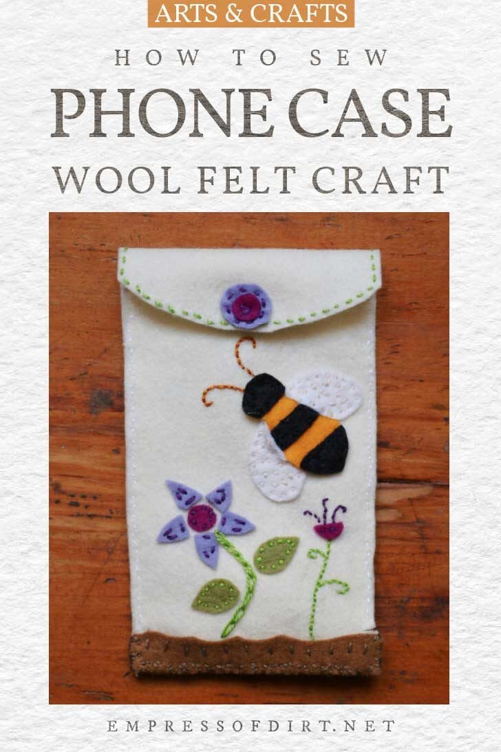 Handmade mobile phone case made from wool felt with decorative bee and flowers.