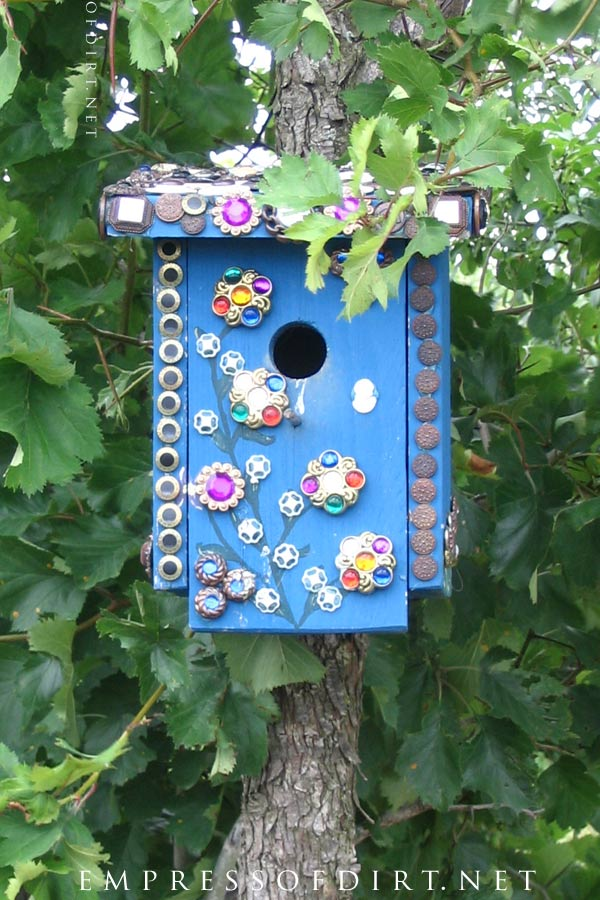 Bedazzled blue garden art birdhouse.