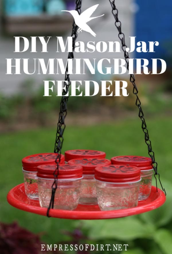 Hummingbird feeder made from mason jars hanging from a chains