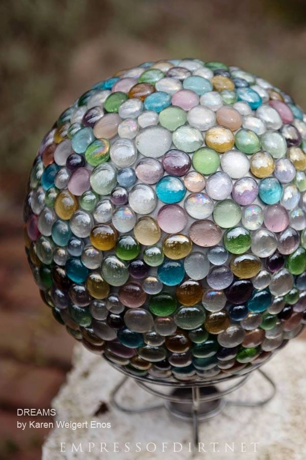 Dreamy garden art ball made from a bowling ball and marbles.
