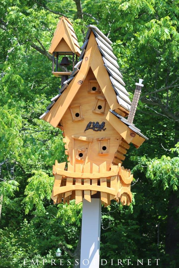 Crazy topsy turvy wooden birdhouse.
