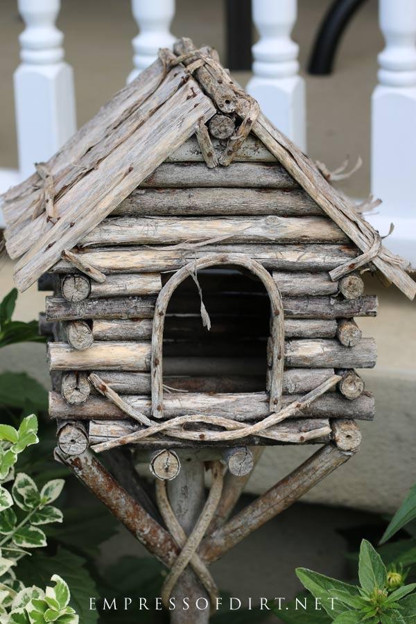 Rustic garden art birdhouse.