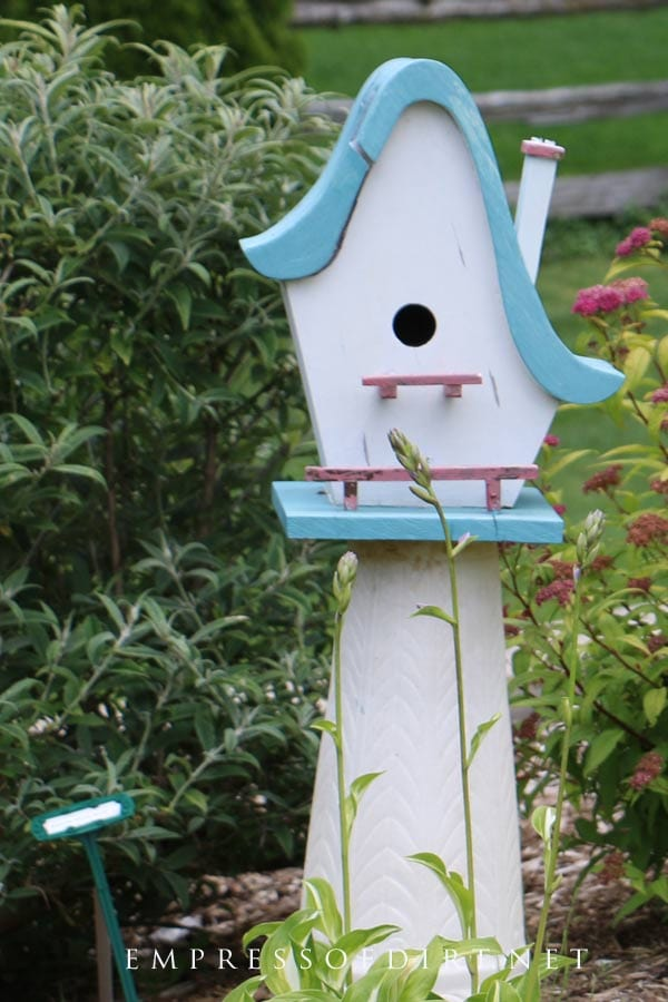Birdshaped garden art birdhouse with chimney.