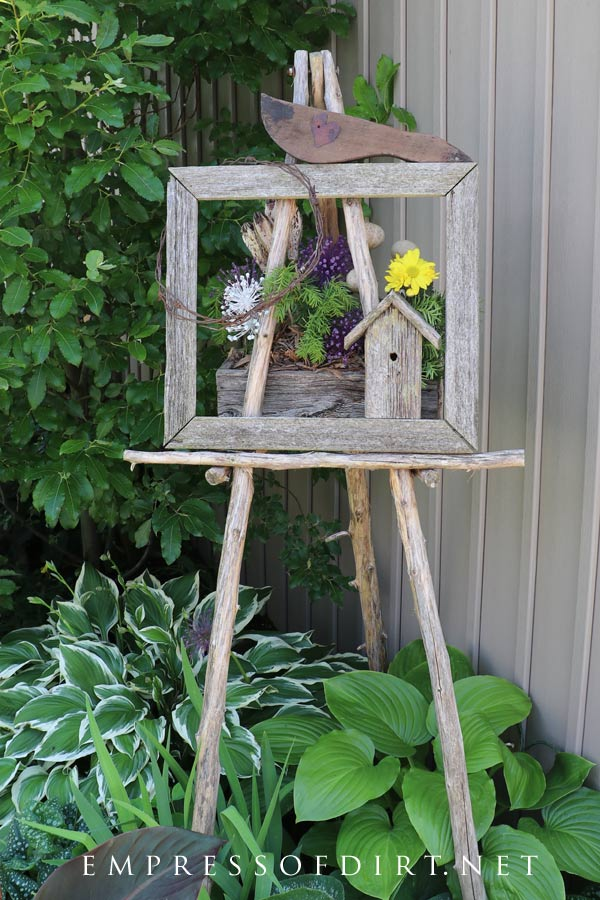 Rustic garden art easel with hostas.