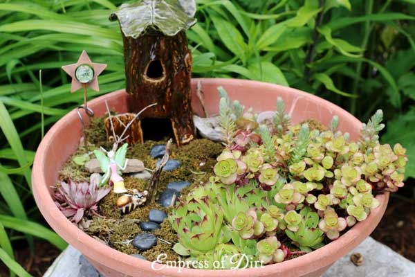Fairy garden in wide terra cotta colored garden container.
