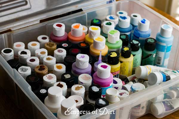 Dab samples of each paint colour on the container lids so you can see what it is at a glance.
