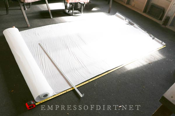 Cutting vinyl sheeting.