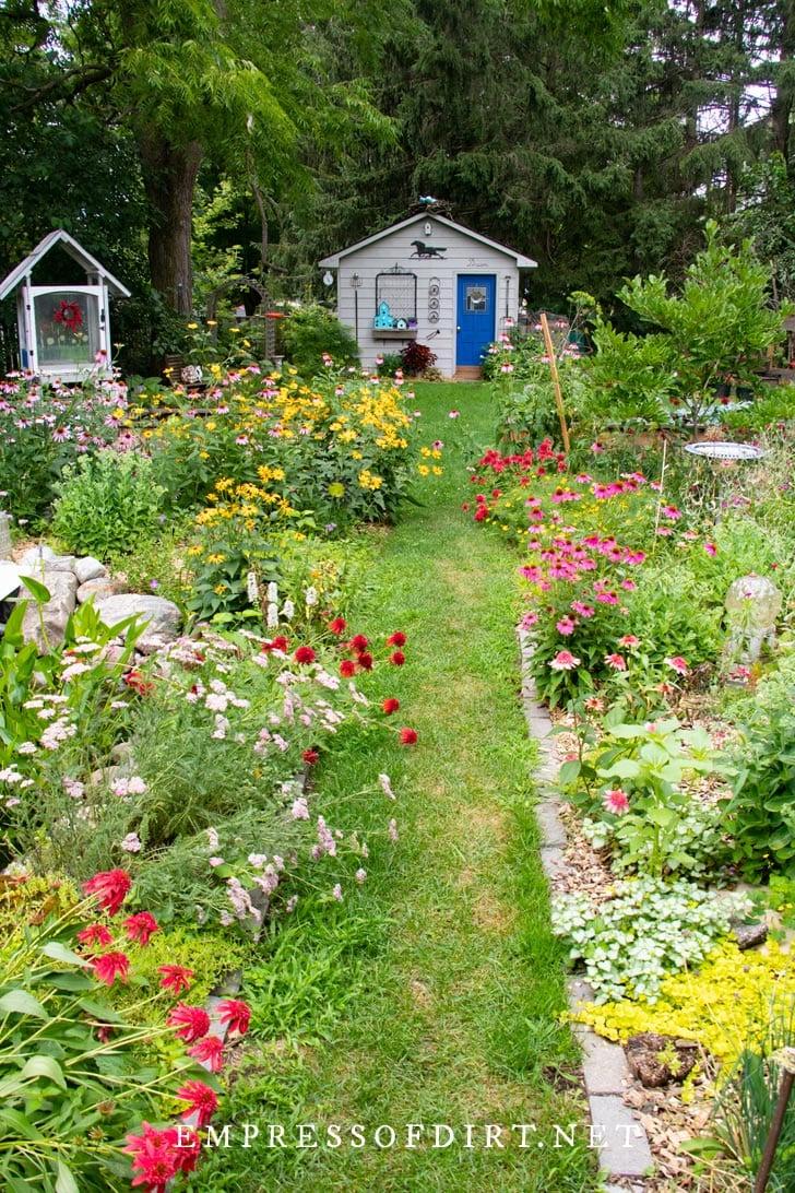 Grass pathway in Empress of Dirt garden.