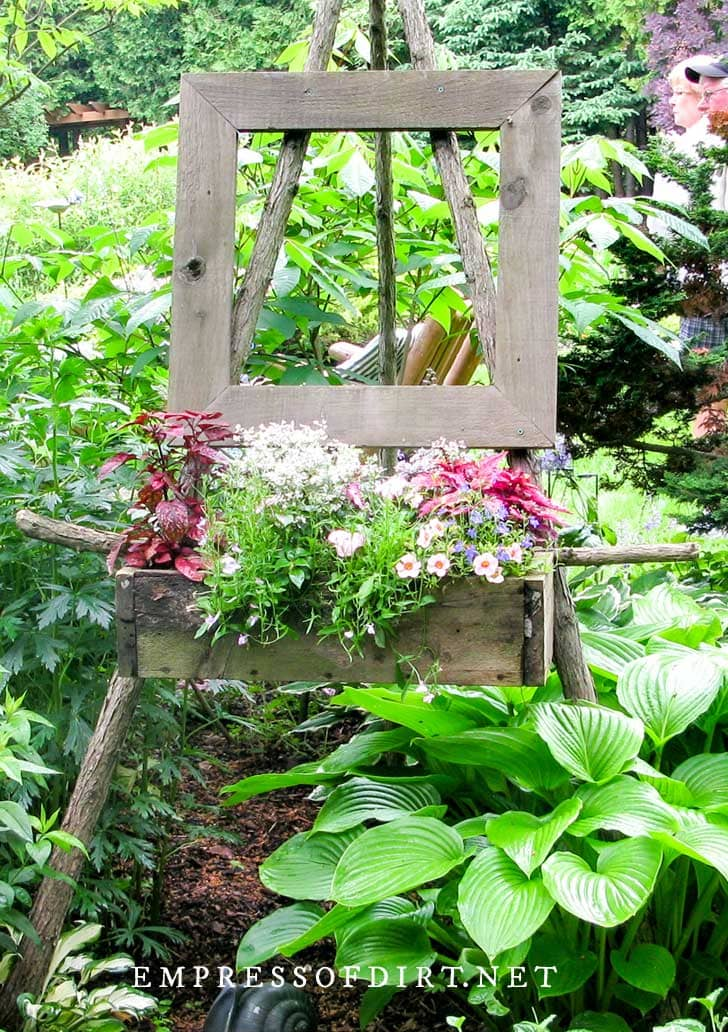 Outdoor easel with flower box.