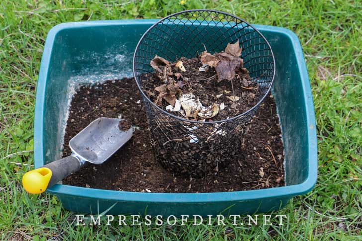 Mesh basket used to sift garden compost.