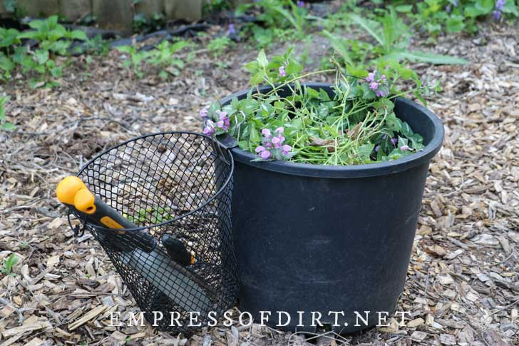 Mesh basket used as a garden tool caddy.