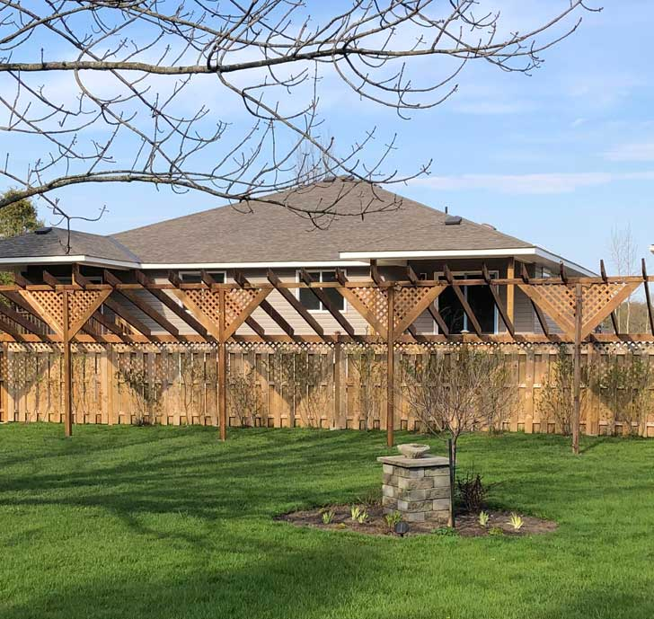 Fence privacy extension made from lattice panels.