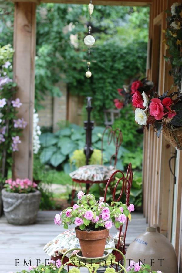 Decorate your shed porch with flowers.