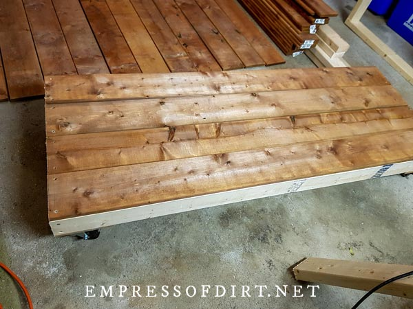 Floor boards attached to base of garden tool shed.