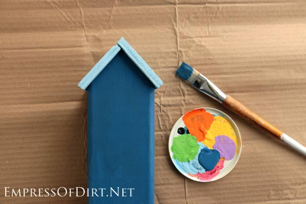 Here's a good soda can craft. Use old fence post wood and pop cans to create these adorable tin-roof cottages. Use a crafting punch tool to make shingles from the metal. Decorate them with nail holes and you're all set.