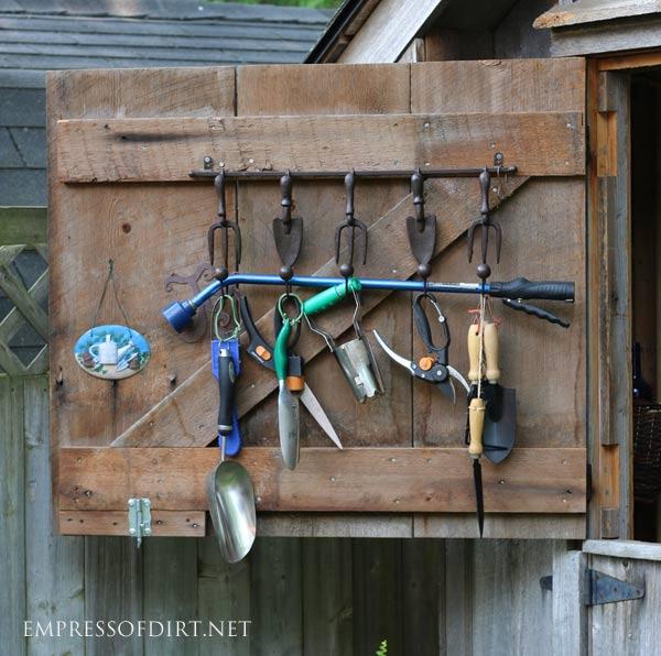 Dutch door garden shed with tools.