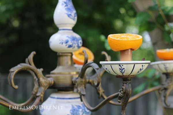 Old blue and white ceramic chandelier turned into an orange feeder for orioles.