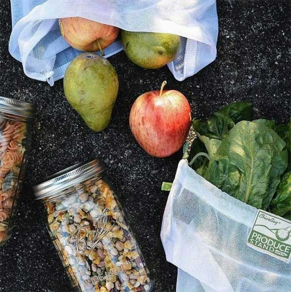 Reusable food shopping bags and glass jars.