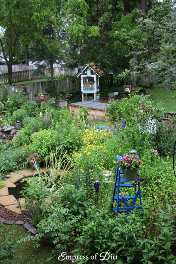 Overview of backyard perennial garden and art.