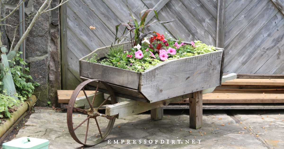 Old-fashioned wagon used as a flower planter.