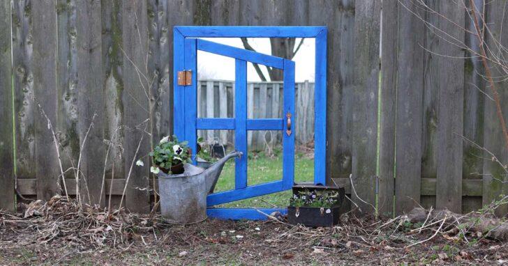 Optical illusion garden mirror painted blue.