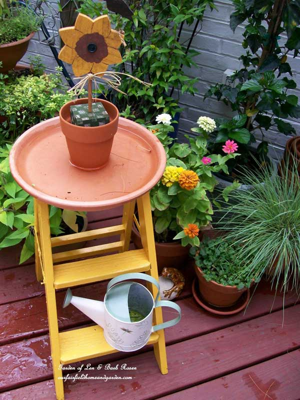A clay saucer on a step ladder makes a great bird bath by Our Fairfield Home and Garden