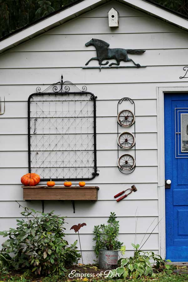 Rustic fall shed makeover with repurposed garden junk
