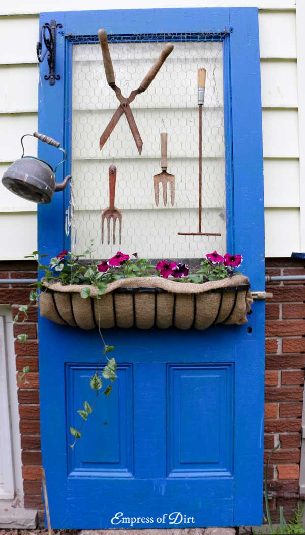 Turn an old farm house door into junk-inspired garden art