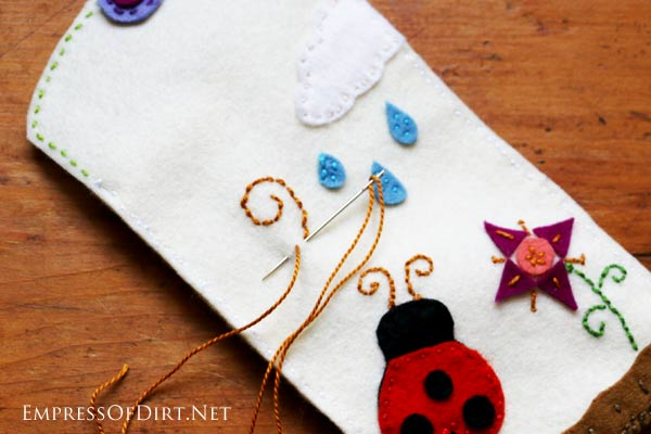 Look out knitting, wool felt crafting is back! If you love creative, portable projects that you can work on wherever you are, wool felt crafts are a great option (and much more frugal than knitting). This phone case is a good beginner project.